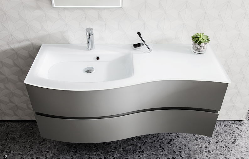 pioneering bathroom manufacturer bauhaus has launched a new range of moulded glass basins to accompany its design led svelte basin unit - Pioneering Bathroom Designs